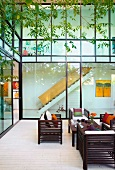 Furnished courtyard with view of interior staircase through glass facade