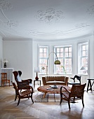 Seating in mixture of styles in grand interior