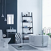 Black and white designer bathroom with free-standing bathtub