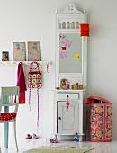 White hallstand with mirror and storage bin with colourful cover