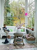Children playing in comfortably-furnished conservatory