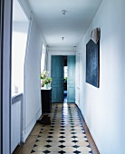 Tiled floor with black inlays in hallway of country house