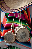 Small drums and ethnic blanket hanging on wall