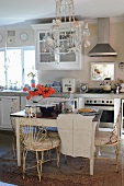 Rustic kitchen with old wooden table and metal chairs