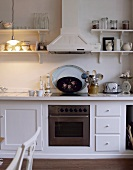 Country house style kitchen counter with extractor hood