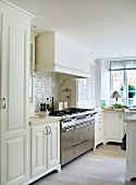 Country house kitchen with large stainless steel gas cooker