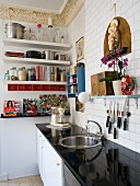 Kitchen counter with glossy black worksurface in traditional setting