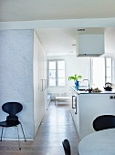Free-standing kitchen island with extractor hood in open-plan, modern kitchen