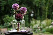 Alliums in bottles decorated with wire and starfish