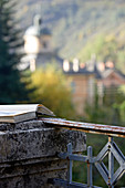 Book lying on weathered stone pillar of roof terrace