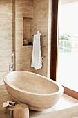 Free-standing, stone bathtub