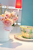 Bouquet of roses with ceramic dish and plate