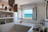 Modern bathroom with open window and sea view