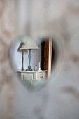 View of bedside cabinet through heart-shaped cut-out