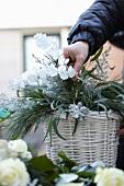 Flower arrangement in white basket