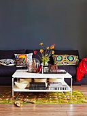 Sitting area in the living room in a mix of styles with sofa, decorative pillows, patterned carpet and coffee table