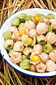 Cape gooseberries in bowl on straw