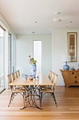 Wooden dining set with metal frames in modern ambiance