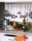 Kitchen utensils and ingredients in a stainless steel kitchen