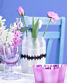 Spring flowers in vases and wine glass