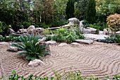 Japanese-style rock garden with patterns raked in gravel