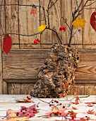 Autumn arrangement of bark, twigs, leaves and rosehips