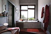 Cosy bathroom with view of landscape from convenient built-in bathtub