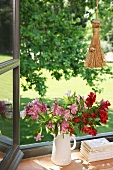 Jug of lilies on window sill
