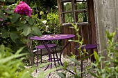 Purple metal garden table and chairs