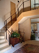 Staircase in foyer with view of gallery