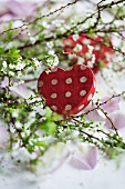 Heart-shaped box amongst flowering branches
