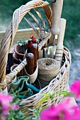 Basket of gardening tools on wooden table