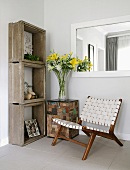 Low chair with woven fabric seat and back next to shelving made from concrete frames