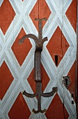 Detail of old wooden door with metal fittings