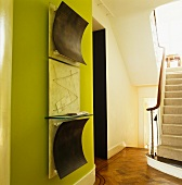 Traditional stairwell with work of art on green-painted wall