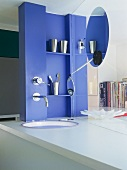 Modern washstand - blue wall with integrated tap fittings and washbasin in white counter