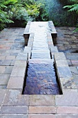 Multilevel pond with slate surround