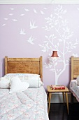 Girl's room with wall stickers on pink wall