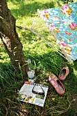 Taking a break in the garden - newspaper and drink under shady tree