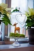 Deer figurine under bell jar as Christmas decorations