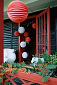 Red and white spherical lanterns as Christmas decorations on terrace