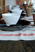 Festive table set with linen table mats, plates and bowls