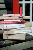 Stack of books and red candle