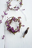Tying wreaths of callicarpa berries