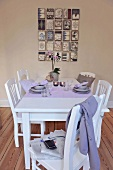 White dining table and chairs with breakfast table settings for two in rustic modern dining room