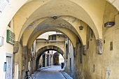 Vaulted arcades in Italian alleyway