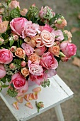 Bunch with pink roses outdoors
