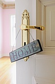 Home sign at door