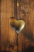 Heart-shaped hole in wooden boards