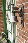 Bell and duck figurine at front door